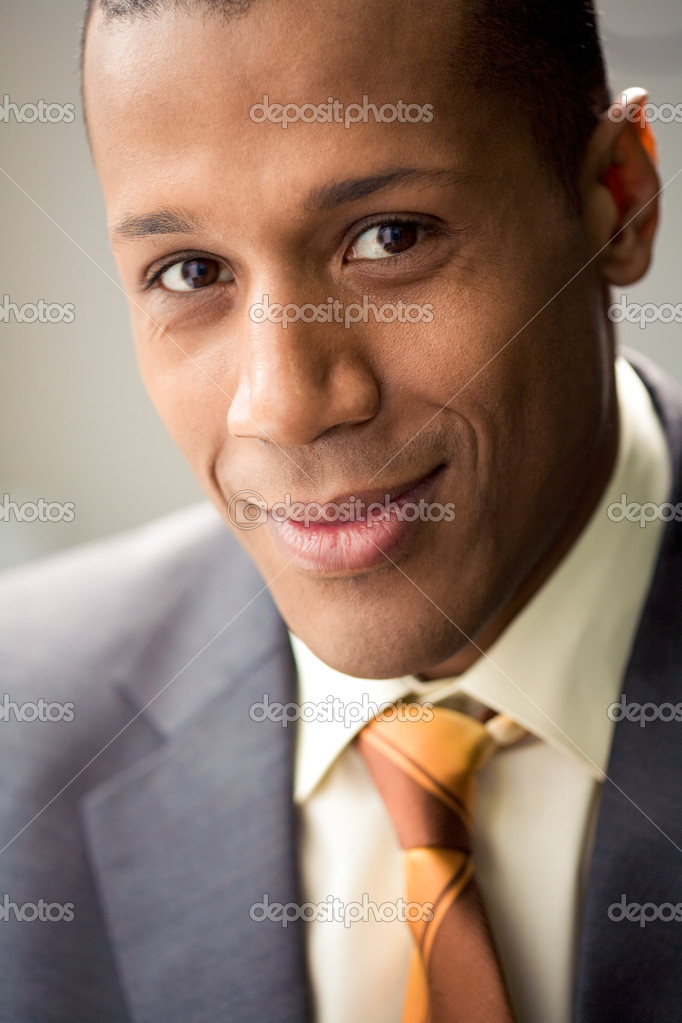 Portrait of successful white collar worker looking at camera and smiling — Stock Photo #10717956