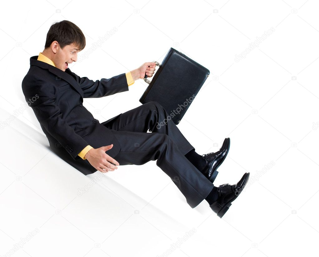 Image of sliding businessman with briefcase in hand over white background — Stock Photo #10717997
