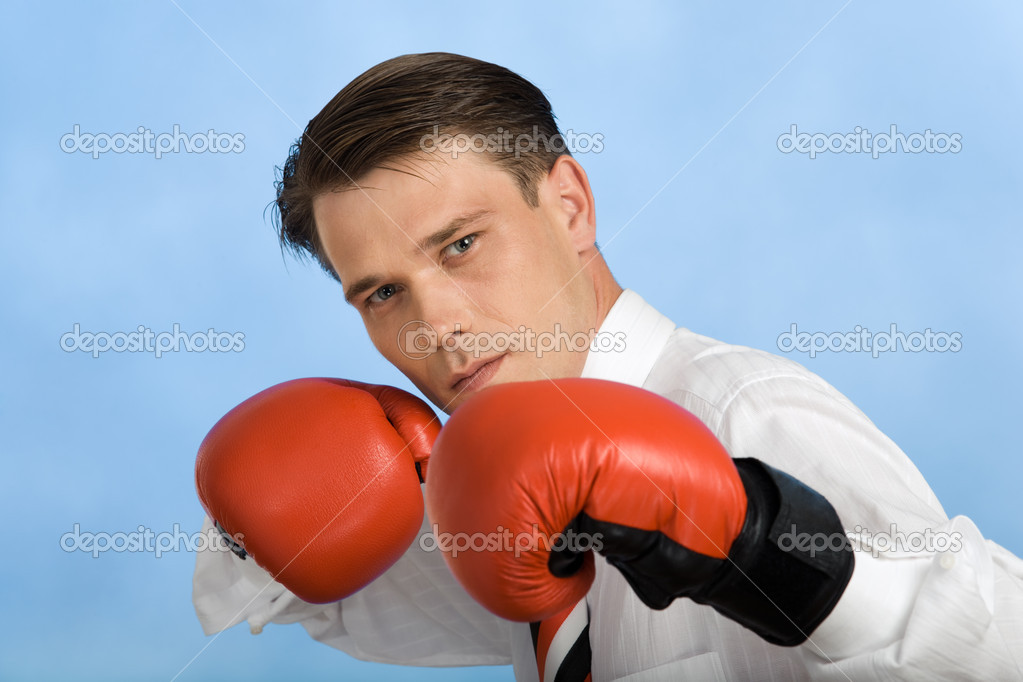 Image of handsome man defending himself by gloved punches gloved — Stock Photo #10718082