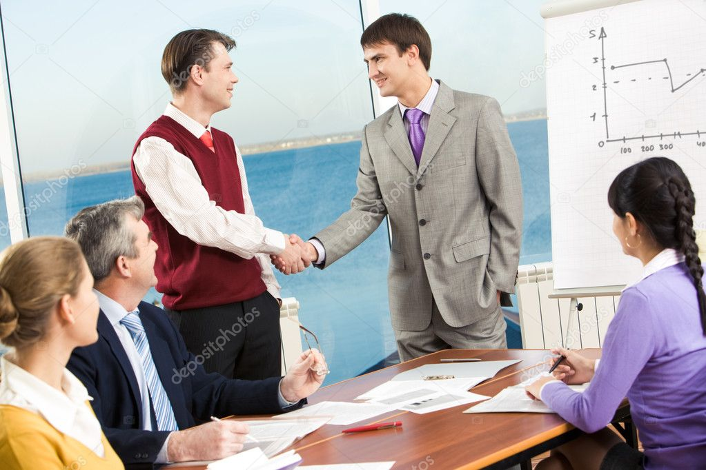 Portrait of successful business partners handshaking after negotiations — Stock Photo #10718380