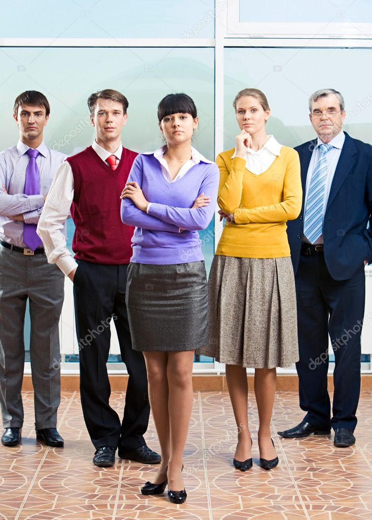 Photo of confident managers standing in office with young lady in front — Stock Photo #10718385