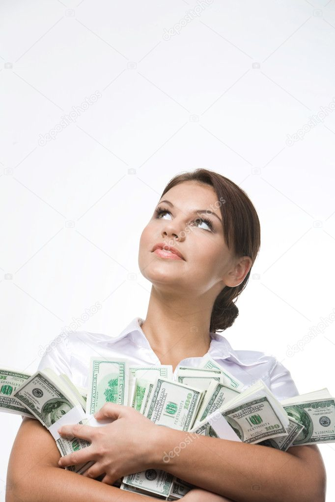Portrait of charming lady holding bills of dollars and looking upwards — Stock Photo #10718431