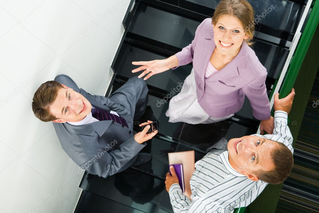 Image of business partners standing on staircase — Stock Photo #10718611
