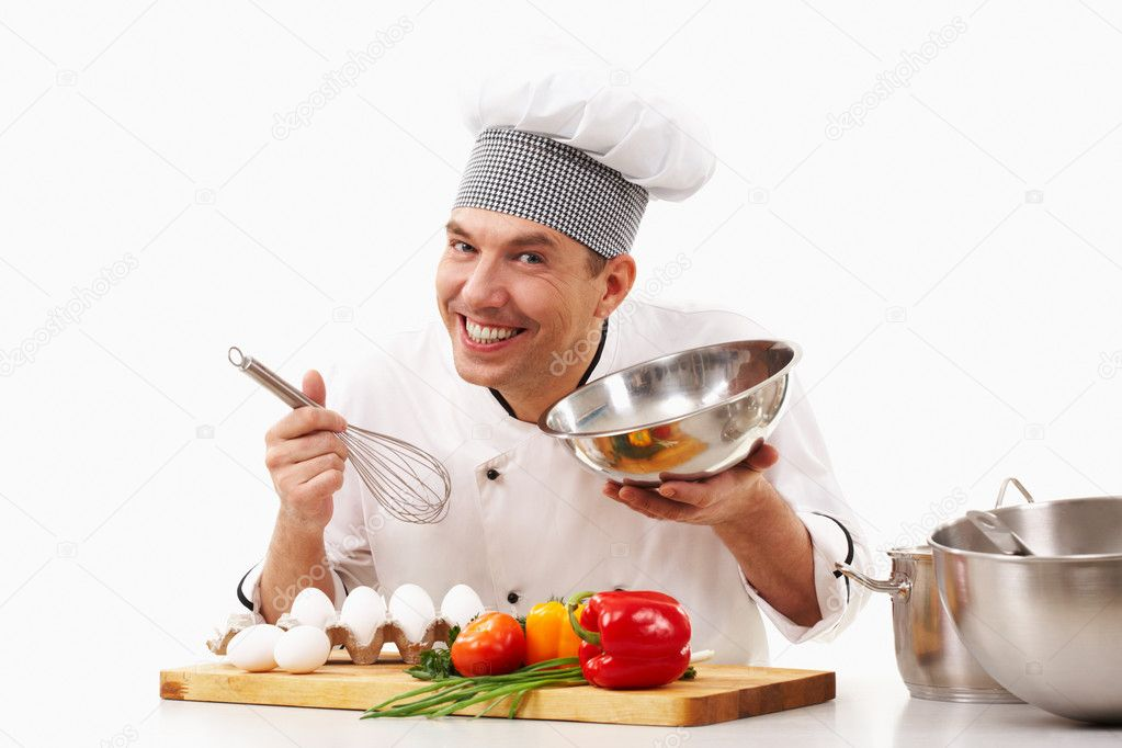 Portrait of handsome man in cook uniform smiling at camera during work  Stock Photo #10718824