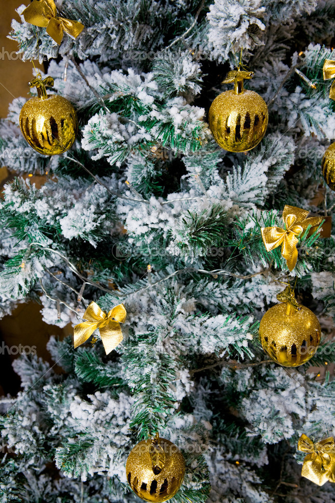 Close-up of Christmas fir tree decorated with artificial snow and toy balls — Stock Photo #10719095