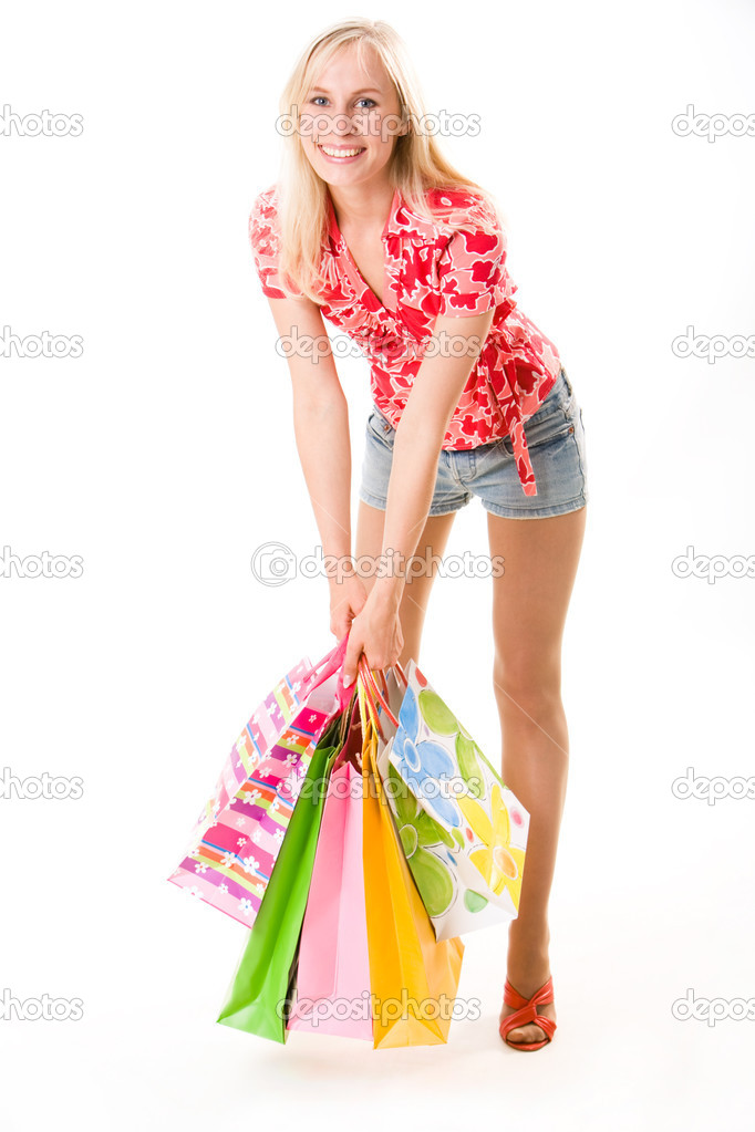 Image of beautiful woman with shopping bags in hand standing in the studio  Stock Photo #10719309