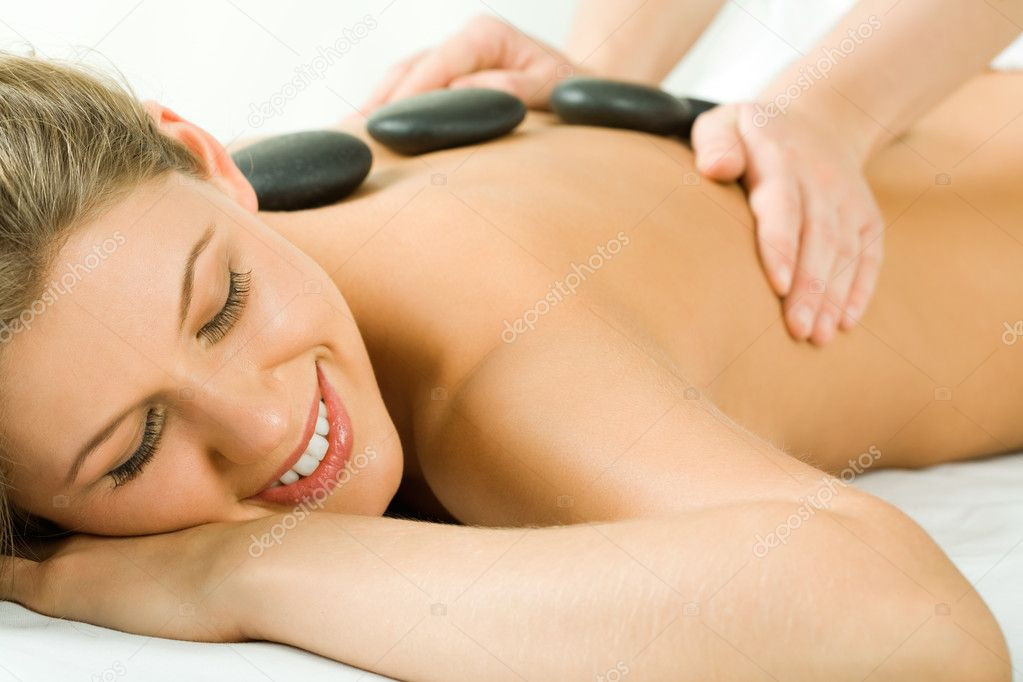 Portrait of attractive woman getting a massage at the day spa — Stock Photo #10729905