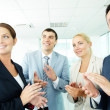 Photo of business partners applauding while looking at spokesman — Stock Photo #10731604