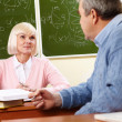 Consulting with teacher — Stock Photo