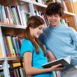 Reading book at library — Stock Photo