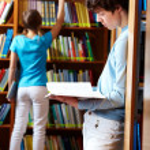 Looking through books — Stock Photo