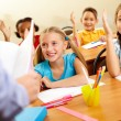 Image of pupils raising arms during the lesson — Stock Photo #10733063