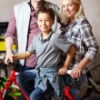 Family with bike — Stock Photo #10733161