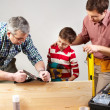 Male members of the family spending time together in a woodshop — Stock Photo #10733241