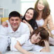 Happy family at home — Stock Photo #10733259