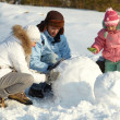 Stock Photo: Making snowman