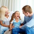Portrait of happy daughter laughing and looking at her father — Stock Photo
