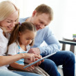 Family on sofa — Stock Photo #10733485