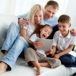 Stock Photo: Family on sofa