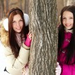 Girls by tree — Stock Photo