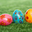 Stock Photo: Colored eggs on lawn
