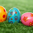 Colored eggs on lawn — Stock Photo