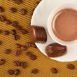 Cappuccino and chocolates — Stock Photo