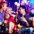 Friends in hookah room — Stockfoto
