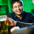 Friends at bar — Stock Photo