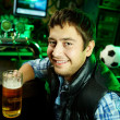 Stock Photo: Guy at sport bar
