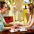 Stock Photo: Couple in restaurant