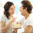 Couple eating cake — Stock Photo