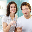 Couple drinking water - Stock Photo