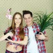 Foto Stock: Couple with plants