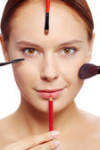 Female with makeup tools — Stock Photo