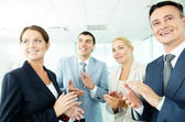 Photo of business partners applauding while looking at spokesman — Stock Photo
