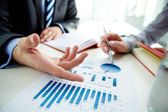 Hand pointing at business document — Stock Photo