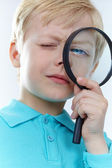 Looking through magnifying glass — Stock Photo