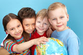 Cute kids with globe — Stock Photo