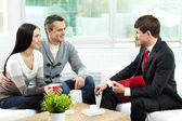 Couple and agent — Stock Photo