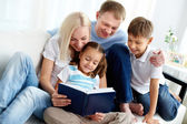 Family with book — Stock Photo