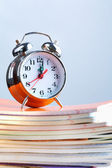 Clock and copybooks — Stock Photo