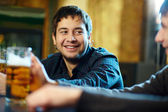 Man with beer — Stock Photo