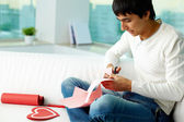 Cutting paper heart — Stock Photo