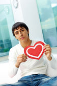 Man with paper heart — Stock Photo