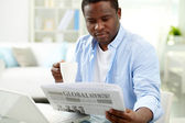 Guy with newspaper — Stock Photo