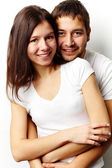 Vertical portrait of a flirting couple isolated against white background — Stock Photo