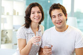 Couple drinking water — Stock Photo