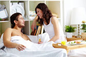 Chatting in bed — Stock Photo