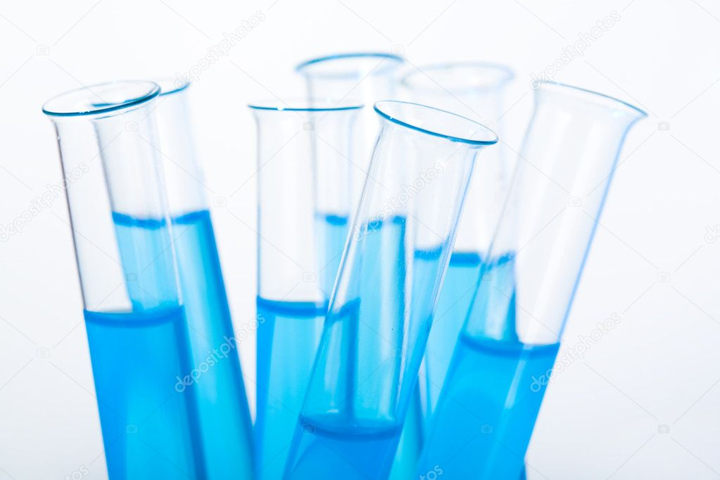 Image of several medical flasks with blue water on a white background — Stock Photo #10730112
